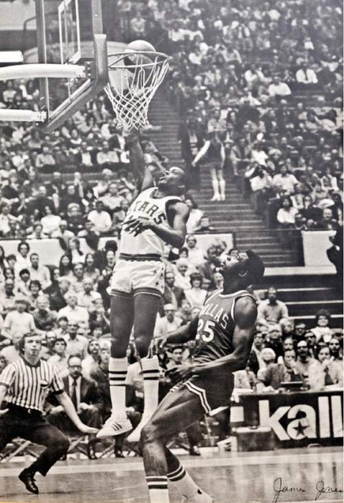courtesy photo  Utah Stars guard Jimmy Jones (15) lays the ball up over Dallas Caparrals forward Coby Dietrick (25) during an ABA game at The Salt Palace.