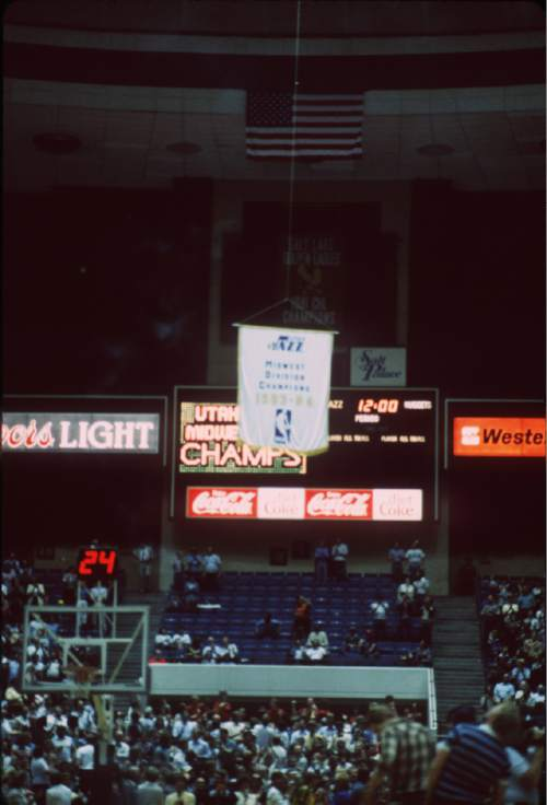 |  Courtesy Utah Jazz  The 1983-84 Midwest Division Champions banner is raised into place int he Salt Palace.