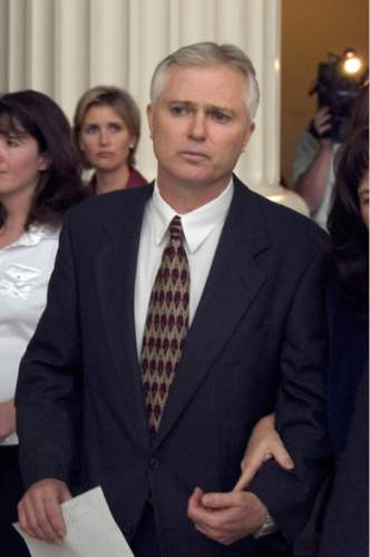 Rick Egan  |  The Salt Lake Tribune   Polygamist John Daniel Kingston exits the court house after the hearing with Judge Valdez Friday October 22, 2004.