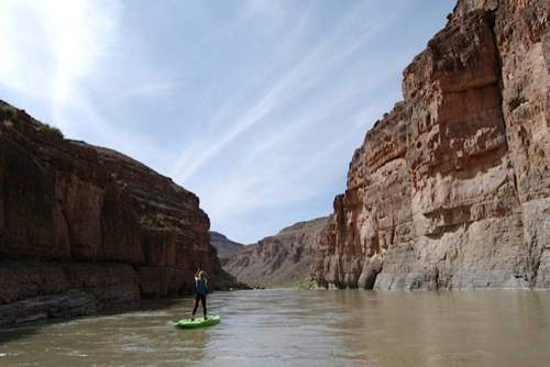 Brian Maffly     The Salt Lake Tribune  Olivia Bailey of Salt Lake City paddles down the San Juan River downstream from Bluff. The cliffs on the right side of the river are part of three different conservation proposals centered on Cedar Mesa. The left side of the river is the Navajo Reservation.