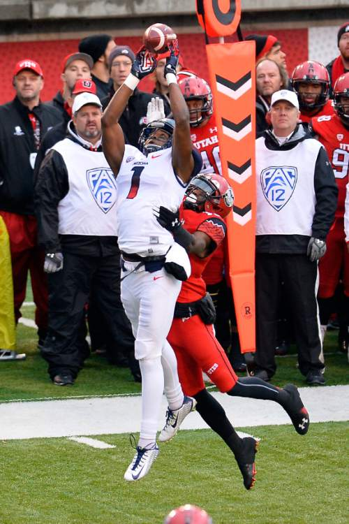 Chris Detrick     The Salt Lake Tribune Arizona Wildcats wide receiver Cayleb Jones (1) can't make a catch while being covered by Utah Utes wide receiver Dominique Hatfield (15) during the game at Rice-Eccles Stadium Saturday November 22, 2014.