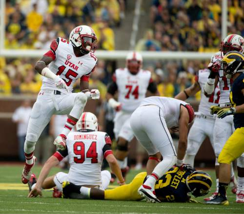 Jeremy Harmon     The Salt Lake Tribune  Utah Utes wide receiver Dominique Hatfield (15) celebrates a play as the Utes face the Wolverines in Ann Arbor, Saturday, Sept. 20, 2014.