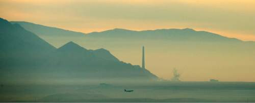 Steve Griffin  |  The Salt Lake Tribune  An airliner glides into the Salt Lake International Airport as haze blankets the western sky in Salt Lake City, Tuesday, December 9, 2014.