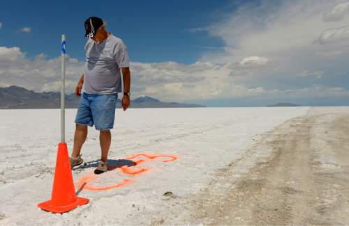 """Leah Hogsten     The Salt Lake Tribune """"If we tried to run a race, we'd be looking for an accident,"""" said Dennis Sullivan, president of the Utah Salt Flats Racing Association or USFRA. Sullivan kicks at the dangerously thin, popcorn-like salt on Course #2 that reveals unstable dirt below that is hazardous for driving upon at such high speeds.  There are four """"courses"""" on the Bonneville Salt Flats used by the Utah Salt Flats Racing Association, but only the two longest--Course #1 or the """"Short"""" course that is 3-5-miles and Course #2 or the """"Long"""" Course that is 5-7-miles--are operational during Speed Week. Levels of salt at the Bonneville Salt Flats are depleting rapidly. Many mineral extraction companies use salt from the flats, diverting the lake's natural water supply, affecting already record low lake water levels. All of these factors contribute to lack of salt on the salt flats that recharge naturally by regular flooding and ebb and flow of the salt water."""