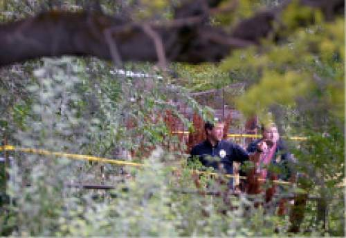 Al Hartmann  |  The Salt Lake Tribune West Valley City police investigate a backyard horse pasture near 5200 W. and 3600 S. in West Valley City where the body of a 12-year-old girl was found Friday July 17.