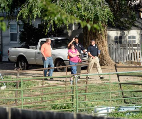 Al Hartmann  |  The Salt Lake Tribune West Valley City police interview neighbors near a backyard horse pasture at 5200 W. and 3600 S. in West Valley City where the body of a 12-year-old girl was found Friday July 17.
