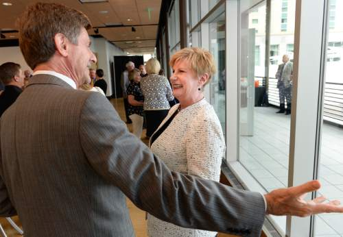 Francisco Kjolseth  |  The Salt Lake Tribune Deborah Bayle, CEO of the United Way of Utah who retired July 1, speaks with Phil Cofield during her retirement party at the Gallivan Center on Thursday, June 11, 2015. Bayle was sometimes controversial as a CEO who revamped the United Way and its focus, away from being a fundraiser for many nonprofits to being focused on a specific community goal.