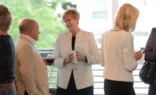 Francisco Kjolseth  |  The Salt Lake Tribune Deborah Bayle, center left, CEO of the United Way of Utah who retired July 1, attends her retirement party at the Gallivan Center on Thursday, June 11, 2015. Bayle was sometimes controversial as a CEO who revamped the United Way and its focus, away from being a fundraiser for many nonprofits to being focused on a specific community goal.