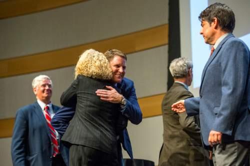 Chris Detrick     The Salt Lake Tribune Businessman Dave Robinson and former state legislator Jackie Biskupski hug after the Salt Lake City Mayoral Debate at Salt Lake City's Main Library Thursday July 16, 2015.