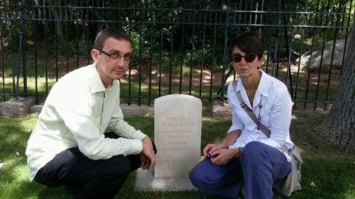 Dawn House  |  Courtesy   Piero Montedoro and Donatella Daugenti, the nephew and niece of POW Nicola Daugenti, visit Nicola's grave site at the Fort Douglas Cemetery on Monday July 20, 2015.