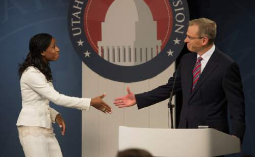 Steve Griffin     The Salt Lake Tribune  Mia Love shakes hands with Doug Owens following a debate at the University of Utah in Salt Lake City on Tuesday, October 14, 2014.