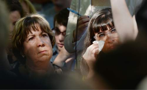 Steve Griffin  |  The Salt Lake Tribune   Kate Kelly, right, founder of the The Ordain Women organization, wipes tears from her eyes as she stands with her mother Donna Kelly, during a vigil at City Creek Park, in Salt Lake City, Utah Sunday, June 22, 2014.  The event coincided with the church disciplinary court underway at Kate's former stake center in Virginia. Kate no longer lives in Virginia, and is living in Utah before she moves to Kenya with her husband..