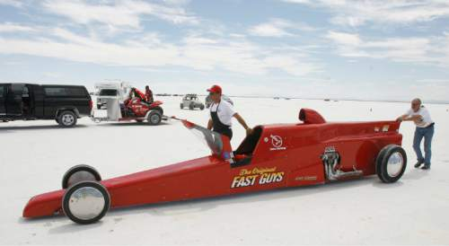"Rick Egan   |  The Salt Lake Tribune  Calvin Dirks (left) and Cameron Shadle push ""The Original Fast Guys""  car to the starting line as driver Ed Shadle takes a run on the Salt Flats, during Speed Week, at the Bonneville Salt Flats, Thursday, August 18, 2011."