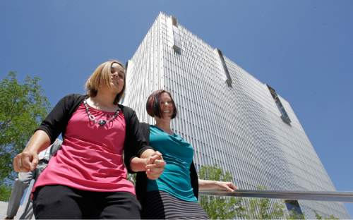 Angie, left, and Kami Roe of West Jordan leave the federal courthouse Wednesday, July 15, 2015, in Salt Lake City. A federal judge has ordered the state of Utah to list the names of the lesbian couple on a birth certificate as the mothers of their new baby. U.S. District Judge Dee Benson said Wednesday the case wasn't hard to decide in the wake of the U.S. Supreme Court ruling legalizing same-sex marriage. (AP Photo/Rick Bowmer)