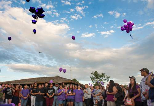 Rick Egan  |  The Salt Lake Tribune  Friends and family of Kailey Vijil release purple balloons as they gathered for a candle light vigil, in memory of the 12-year-old West Valley City girl who died earlier this week, Sunday, July 19, 2015.