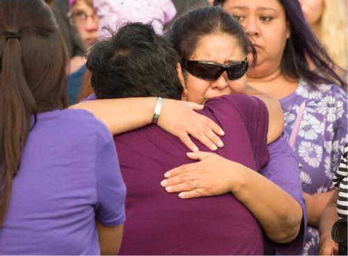 Rick Egan  |  The Salt Lake Tribune  Deshawn Vijil, mother of Kailey Vijil is comforted by a loved one, as friends and family of Kailey Vijil gather for a candle light vigil, in memory of the 12-year-old West Valley City girl who died earlier this week, Sunday, July 19, 2015.