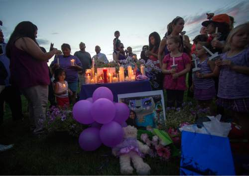 Rick Egan  |  The Salt Lake Tribune  Balloons, stuffed animals and other mementos were placed in remembrance of Kailey Vijil, at a candle light vigil, in memory of the 12-year-old West Valley City girl who died earlier this week, Sunday, July 19, 2015.