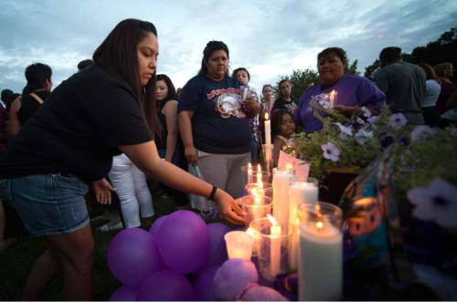 Rick Egan  |  The Salt Lake Tribune  Shanda Charley lays a candle in remembrance of Kailey Vijil, as friends and family gathered for a candle light vigil, in memory of the 12-year-old West Valley City girl who died earlier this week, Sunday, July 19, 2015.