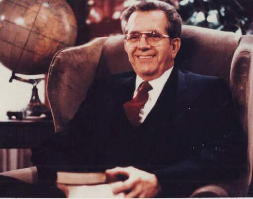 Courtesy  |  LDS Church  Elder Boyd K. Packer holding the new editions of the scriptures, 1982.