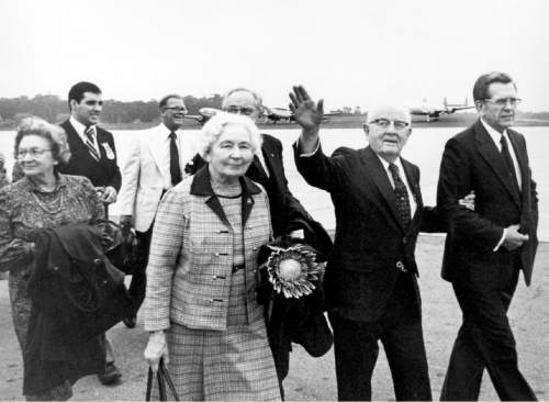 Courtesy  |  LDS Church  President and Sister Kimball walking on an airport tarmac with Elder Boyd K. Packer and Elder and Sister Gordon B. Hinckley, 1980s in Montevideo, Uruguay.