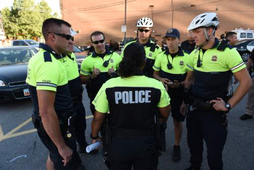 Francisco Kjolseth  |  The Salt Lake Tribune Bike cops get briefed with the Salt Lake Police Department get briefed before the start of their patrol the night before the start of the Pioneer Day parade.
