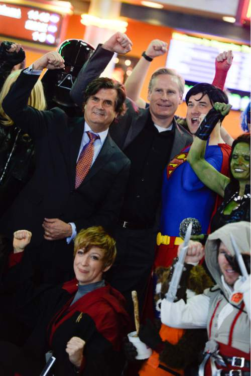 Francisco Kjolseth  |  The Salt Lake Tribune Bryan Brandenburg, center left, and Dan Farr, co-founders of the Salt Lake Comic Con join cosplay fans for a picture following their announcement of FanX, Jan. 29-31, 2015 during a press announcement at the Megaplex 17 at Jordan Common in Sandy on Wednesday, Nov. 19, 2014.