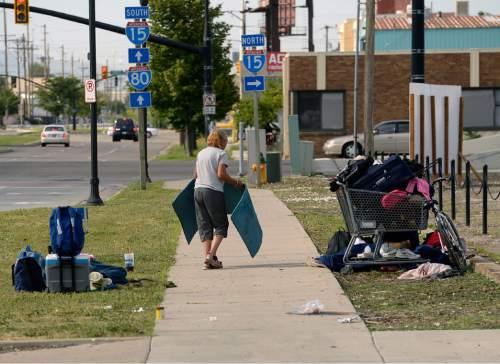 Al Hartmann     Tribune file photo Homeless woman breaks down her camp near 500 W. and 350 S. in Salt Lake City.