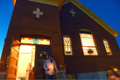 Leah Hogsten     The Salt Lake Tribune l-r James Green and Rev Nurjhan B. Govan during vigil services outside. Trinity AME Church held a half hour vigil to honor the nine victims of the Charleston, SC shooting and an hour-long discussion afterwards. The SLC congregation is one of several AME churches across the nation in taking part in the vigil, July 24, 2015.