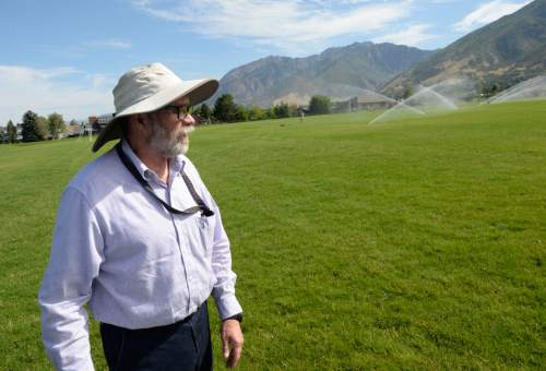 Al Hartmann  |  The Salt Lake Tribune Christopher Eppler, energy specialist with Canyons School District oversees water management interns at Albion Middle School in Sandy Tuesday July 21.  The internships are payed through the Central Utah Water Conservency District to help make watering grounds at 15 schools in the Canyons School District more efficient and the grass healthier.