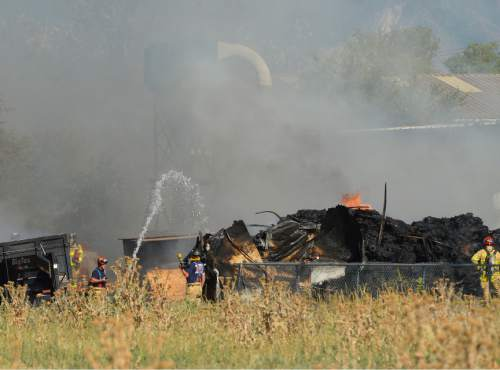 Leah Hogsten  |  The Salt Lake Tribune A fire, reported about 3:45 p.m. Sunday, July 25, 2015, started at 879 S. Gladiola St., near a 78,000-square-foot, one-story building used by a furniture company was quickly put out. Captain Mark Bednarik with the Salt Lake City Fire Department said semi-trailers and pallets first caught fire, before the blaze began to spread to the building itself as firefighters arrived. No employees were there at the time the fire began, Bednarik said, and there are no injuries.