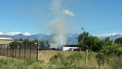 Michael McFall | The Salt Lake Tribune  Firefighters were responding Sunday afternoon to a three-alarm industrial fire near 3400 W. 900 South in Salt Lake City.