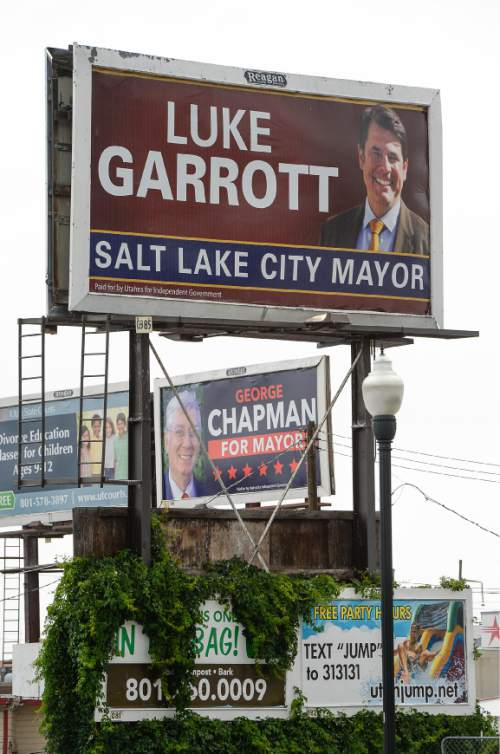 Francisco Kjolseth | The Salt Lake Tribune A political action committee formed by Reagan Outdoor Advertising is putting up billboards of opponents to Mayor Ralph Becker. First they put them up for Jackie Biskupski. Now they're putting them up for Luke Garrott, George Chapman and Dave Robinson. On 900 South between State and Main billboards for Luke Garrott and George Chapman can be seen close together.
