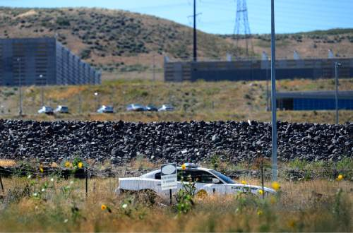 Scott Sommerdorf   |  The Salt Lake Tribune A UHP trooper sits at the entrance to the Utah Data Center last week.