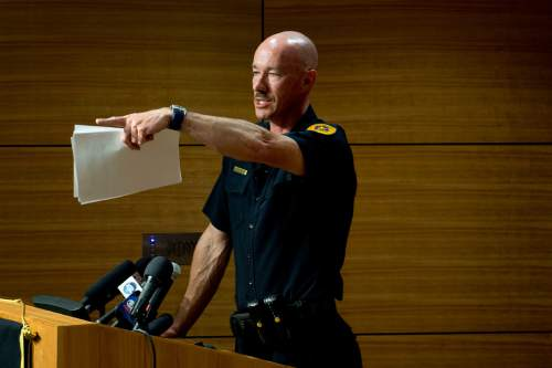 Jeremy Harmon  |  The Salt Lake Tribune  Salt Lake City Police Chief Chris Burbank answers questions on June 27, 2014, during a press conference about the June 18th incident where Officer Brett Olsen shot and killed Sean Kendall's dog, Geist.