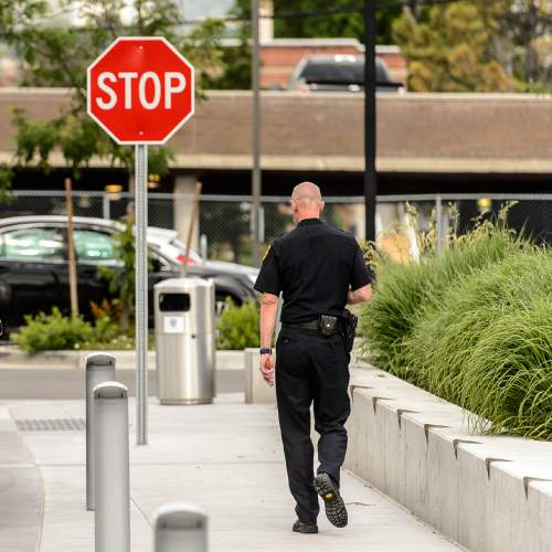 Trent Nelson  |  The Salt Lake Tribune Former Salt Lake City Police Chief Chris Burbank walks off after speaking to reporters about his departure in front of the Public Safety Building in Salt Lake City Thursday June 11, 2015.