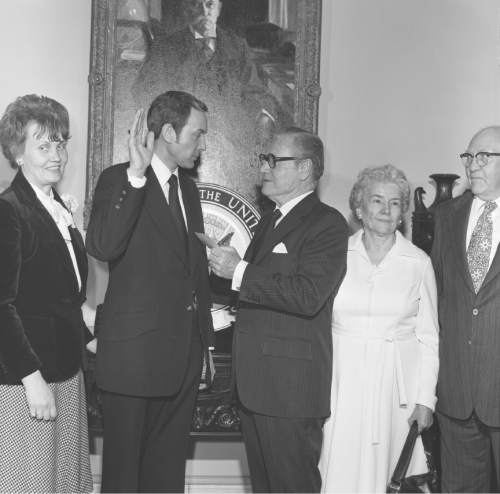 Photo Courtesy of U.S. Senate Historical Office  Vice President Normal Rockefeller administers the oath of office to Sen. Orrin Hatch in January 1977, with his parents on the right and his wife Elaine on his left.
