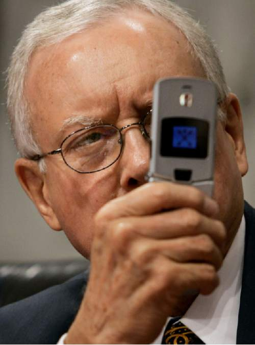 Senate Judiciary Committee member, Sen. Orrin Hatch, R-Utah, uses a cellphone camera as Chief Justice nominee John Roberts testifies at his confirmation hearing before the committee on Capitol Hill Thursday, Sept. 15, 2005. (AP Photo/Charles Dharapak)