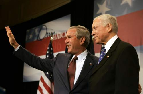 President Bush waves to the crowd during a fundraiser for the reelection campaign of Sen Orrin Hatch, R-Utah, right, on Thursday, Aug. 31, 2006 in Salt Lake City, Utah.  (AP Photo/Evan Vucci)