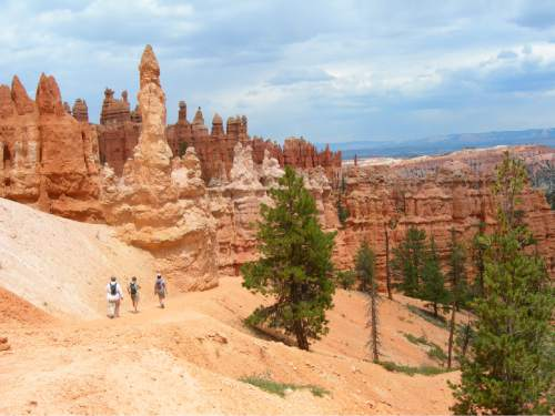 | Tribune File Photo  Hikers approach hoodoos on the Peekaboo Trail in Bryce Canyon National Park.