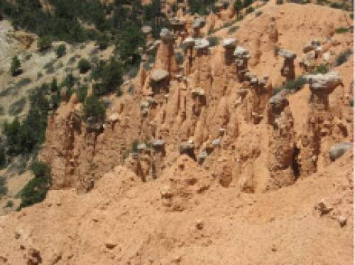 Nate Carlisle  |  The Salt Lake Tribune   The Hat Shop consists of spires of red rock with wider white rocks on top. The trail has few visitors and is part of a larger trail system called the Under the Rim Trail.