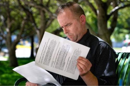 "Scott Sommerdorf   |  The Salt Lake Tribune Mayor Becker's spokesman Art Raymond looks over a transcript of comments he has made while commenting on Trib message boards disparaging Becker opponents using his ""Whiskey Pete"" pseudonym. He talked to the Tribune about it on the grounds of the City and County Building, Thursday, July 30, 2015."