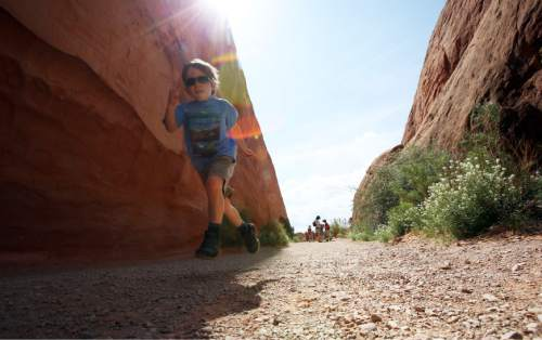 Francisco Kjolseth  |  The Salt Lake Tribune Johnny Prokop, 5, takes off down the Devils Garden trail in Arches National park, passing the sounds of numerous foreign languages as visitors from around the world flock to one of the most famous parks in Utah.
