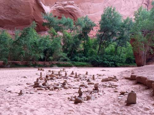 Kristen Moulton  |  The Salt Lake Tribune  Visitors use rocks and pebbles to create whimsical art on the red-sand beaches of Coyote Gulch, south of Escalante, Utah, in late May 2015.