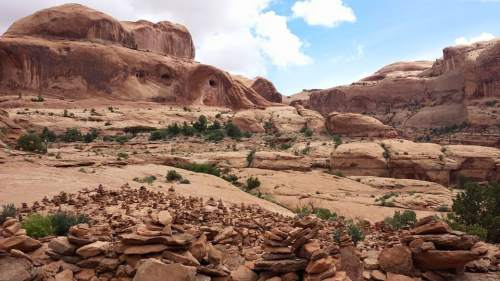 Courtesy  |  Tom Schilling  A field of cairns sits along the trail to Corona Arch near Moab in May 2015.