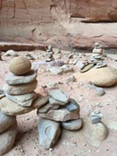 Courtesy  |  Laura Smith Kasmer  Cairns alongside a well-marked trail in Coyote Gulch, Escalante.