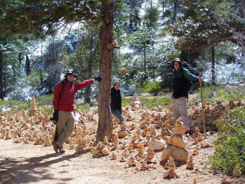 Courtesy  |  Riley Rackliffe Hikers pose for a picture beside a cairn garden in Queen's Garden area of Bryce Canyon.