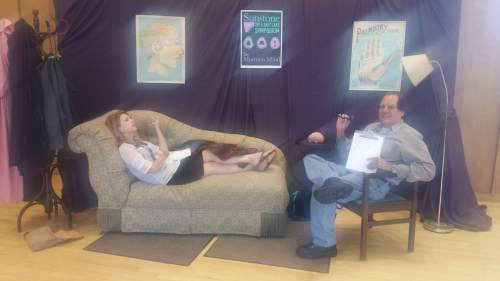 Courtesy photo  Lindsay Hansen Park, organizer of the annual Sunstone Symposium, reclines in a fake psychiatrist's couch, while historian D. Michael Quinn looks on.