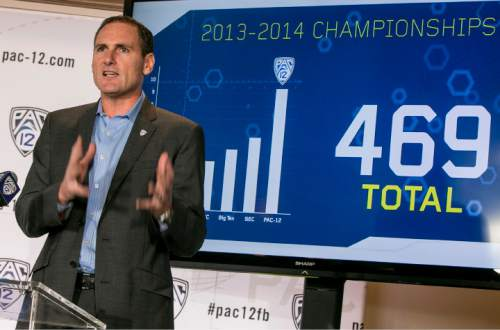 Pac-12 Commissioner Larry Scott delivers the opening remarks of the 2014 Pac-12 NCAA college football media days at Paramount Studios in Los Angeles Wednesday, July 23, 2014. (AP Photo)