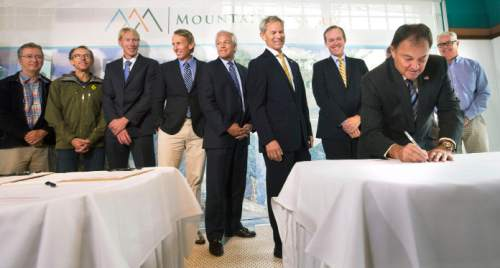 Steve Griffin  |  The Salt Lake Tribune  Gov. Gary Herbert signs documents as he joins organizers that played a role over the past two years in the development of the Mountain Accord at Market Street Grill in Cottonwood Heights, Utah Monday, August 3, 2015. With the signings the Mountain Accord takes another step in creating a special federal designation in the Central Wasatch Range with the goal of preserving the environment and recreational opportunities within this treasured area. The meeting was moved from the mouth of Big Cottonwood canyon to the restaurant because of rain