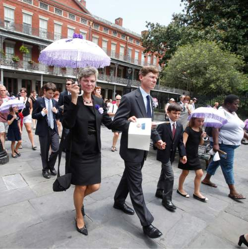Cokie Roberts, daughter of Lindy Boggs, walks with her son Lee Harris Roberts and other family members following the secondline procession for  the funeral for former Rep. Lindy Boggs (D-La.) at St. Louis Cathedral in New Orleans, Louisiana Thursday, August 1, 2013. Hundreds of colleagues, family and friends  turned out for the funeral of Lindy Boggs, a former Democrat member of Congress, ambassador to the Vatican City, champion of civil rights and mother of commentator Cokie Roberts. Boggs died Saturday at age 97. She took a seat in Congress after a plane carrying her husband. U.S. Rep. and Majority Leader Hale Boggs, vanished while on a flight in Alaska in 1972. Photo/ Susan Poag.